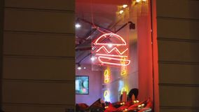 Hamburger neon showcase. cafe window. sign on the wall.sign design stock video