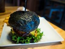 Hamburger nero Immagini Stock Libere da Diritti
