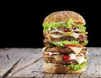 Hamburger on old wooden table. Stock Image