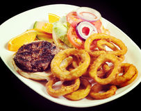 Hamburger with onions rings Royalty Free Stock Images