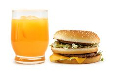 Hamburger and orange juice Stock Images