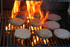 Hamburger patties. On hot grill Royalty Free Stock Images