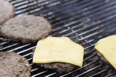 Hamburger Patties on Barbecue. With cheese Royalty Free Stock Image