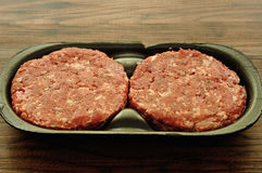Hamburger patties. In a black container Royalty Free Stock Images