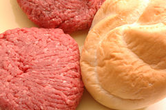 Hamburger patties with bun Royalty Free Stock Images