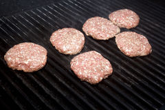 Hamburger Patties. Cooking on a grill Royalty Free Stock Photography