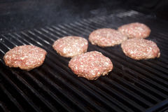 Hamburger Patties. Cooking on a grill Stock Photography