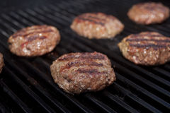 Hamburger Patties. Cooking on a grill Royalty Free Stock Photo