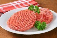 Hamburger patties Stock Images