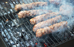 Hamburger patties on the grill Royalty Free Stock Photography