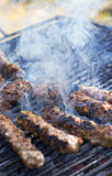 Hamburger patties on the grill Royalty Free Stock Images