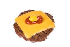Hamburger patty with cheese, mustard and ketchup Stock Images
