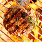 Hamburger patty. On the grilling pan with open flames Stock Photography