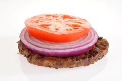 Hamburger patty on white Royalty Free Stock Photos