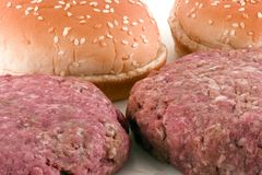 Hamburger Pattys (Raw) and Buns Stock Photography