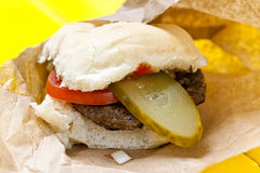 Hamburger with pickle and tomato Royalty Free Stock Photo