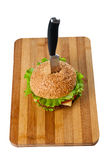 Hamburger pinned with knife Royalty Free Stock Photos