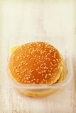 Hamburger in plastic box on white background Royalty Free Stock Images