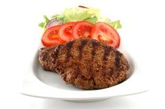 Hamburger plate Stock Images