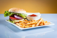 Hamburger on plate Stock Image