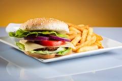 Hamburger on plate Stock Photography