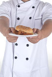 Hamburger on plate in hand of chef Stock Photo