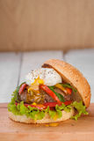 Hamburger with poached egg Royalty Free Stock Photos