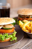 Hamburger with potato chips and drink Stock Photography