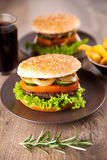 Hamburger with potato chips and drink Royalty Free Stock Photography