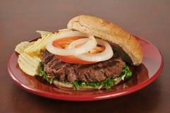 Hamburger and potato chips Royalty Free Stock Images
