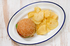 Hamburger with potato chips on white dish Stock Photography