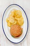 hamburger with potato chips on white dish Royalty Free Stock Photography