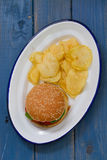 Hamburger with potato chips on white dish Stock Photo