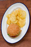 Hamburger with potato chips Stock Photography