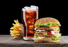 Hamburger, potato fries, cola drink. Royalty Free Stock Photography