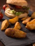 Hamburger and potato Stock Images