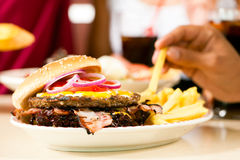Hamburger in a restaurant Stock Photos