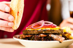 Hamburger in a restaurant Royalty Free Stock Image