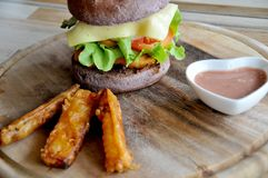 Hamburger in a restaurant. Hamburger, beef and vegetables Stock Images