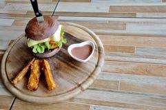 Hamburger in a restaurant. Hamburger, beef and vegetables Royalty Free Stock Photos