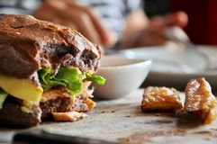 Hamburger in a restaurant. Hamburger, beef and vegetables to bite one. Royalty Free Stock Photo