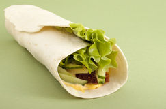 Hamburger-roll. On a green background Royalty Free Stock Photos