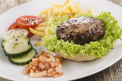 Hamburger with salad on a plate Royalty Free Stock Photography