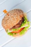 Hamburger with salad, tomato, meat on white backdrop Royalty Free Stock Photo