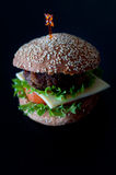 Hamburger with salad, tomato, meat on white backdrop Stock Photo