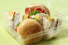 Hamburger and sandwich in box Stock Images