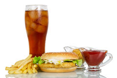 Hamburger, sauces, french fries and cola isolated on white. Background Royalty Free Stock Photo