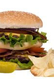 Hamburger Series (bacon cheesburger with pickle and chips). Now that's a hamburger.... two patties, bacon, cheese and lots of greens Stock Photo