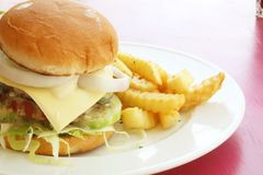 Hamburger Set Meal. On Pink Table During the Day Royalty Free Stock Photo