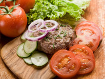 Hamburger with slice vegetables Stock Images